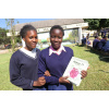 Young orphans in Kitwe, in Zambia, with their class book.<div class='url' style='display:none;'>/en/</div><div class='dom' style='display:none;'>kirchgemeinde.ch/en/</div><div class='aid' style='display:none;'>390</div><div class='bid' style='display:none;'>12251</div><div class='usr' style='display:none;'>235</div>